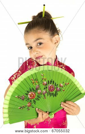 Adorable Girl In Asian Dress Showing A Coy Expression