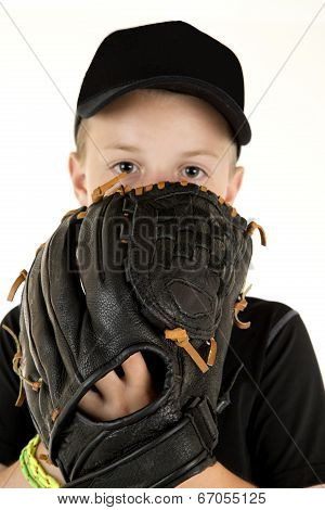 Young Boy Baseball Pitcher Peering Over Glove Ready To Pitch