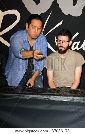 LOS ANGELES - JUN 18:  Joe Hahn, Brad Delson at the Linkin Park Rockwalk Inducting Ceremony at the Guitar Center on June 18, 2014 in Los Angeles, CA