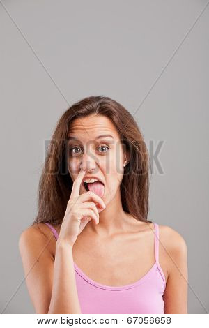 Girl With A Finger In Her Nose