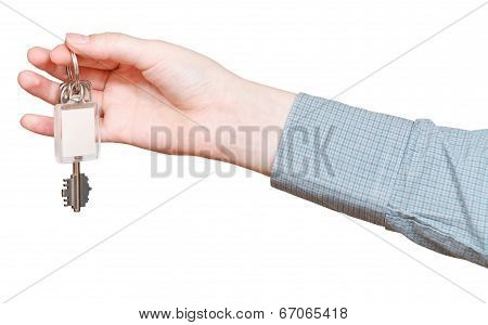 key ring with door's keys in hand