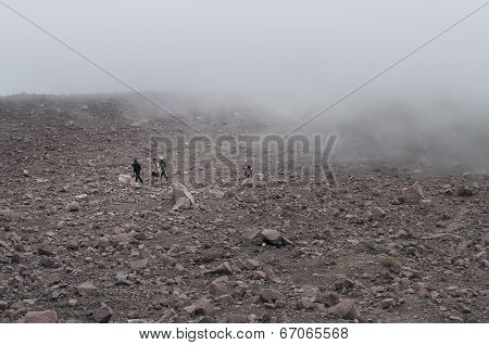 Indonesian Tourists In The Clouds On Volcano Merapi