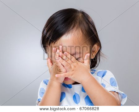 Little girl hand cover her face