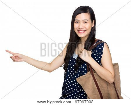 Asian woman with tote bag and finger point out