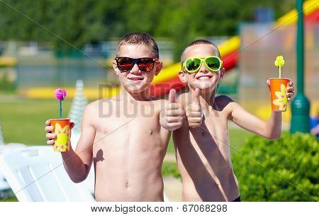 Happy Teenage Boys Showing Thumbs Up In Aquapark