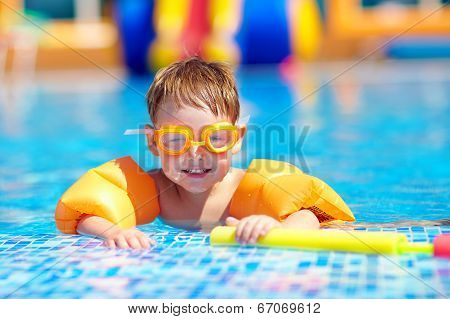 Cute Baby Swimming In Pool With Inflatable Arm Rings