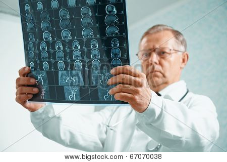 Older Doctor Is Analyzing Mri Image