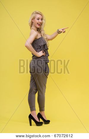 Woman standing on yellow background