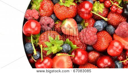 variety of soft fruits, strawberries, raspberries, cherries, blueberries, currants isolated on white