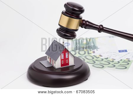 Wooden gavel with house