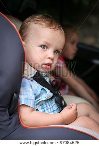 Cute Toddler Boy In Car Seat