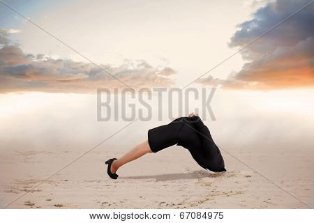 Businesswoman burying her head against misty landscape