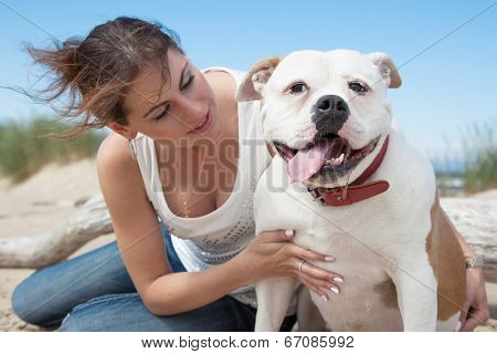 happy young woman walking with dog