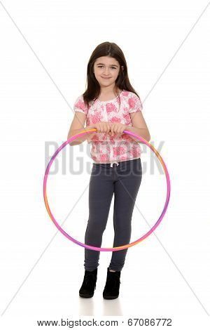 little girl holding hula hoop