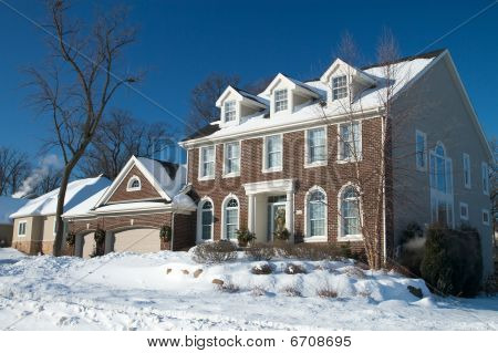 Red Brick Colonial Home in Winter