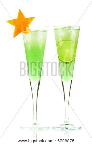 Mint Champagne Alcohol Cocktail With Orange Star And Lime Slice