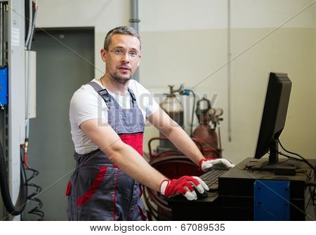 Serviceman near wheel alignment computer