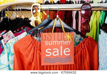 Close up on a big sale sign for summer clothes.