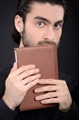 stock photo of priest  - Priest with Holy Bible - JPG