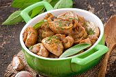 foto of sauteed  - Sauteed mushrooms on the old wooden background - JPG