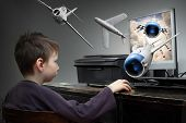 foto of fighter plane  - Happy little boy playing online pc game - JPG