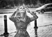 pic of rain-drop  - Beautiful woman wearing a coat posing in the rain - JPG