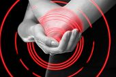 Постер, плакат: Pain In The Elbow Joint Monochrome Image Pain Area Of Red Color