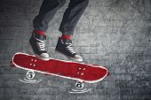 foto of skate board  - Skateboarder jumping on doodle sketched skate board - JPG