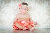 foto of dimples  - Fashionable smiling baby girl in pink panties - JPG