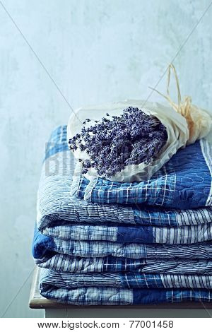Folded Vintage Bedspread and Bunch of Dried Lavender