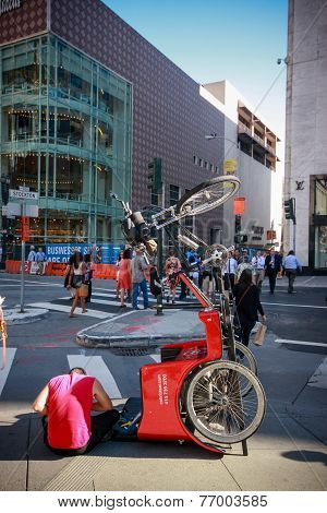 San Francisco, CA, US - Oct 1, 2012: Bicyclist Repairs Tourist Tricycle At Street