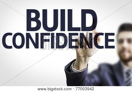 Business man pointing to transparent board with text: Build Confidence