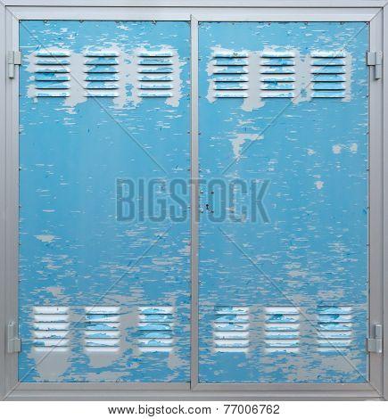 Blue industrial shabby metal door