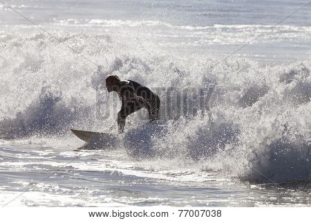Athlete Surfing On Santa Cruz Beach In California