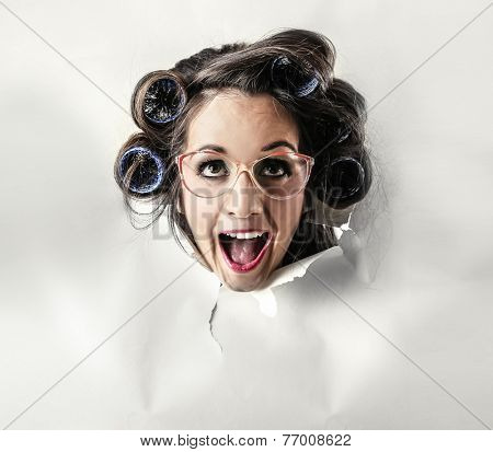 Happy crazy woman popping out from a cardboard