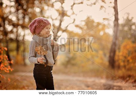cute child girl portrait in autumn forest
