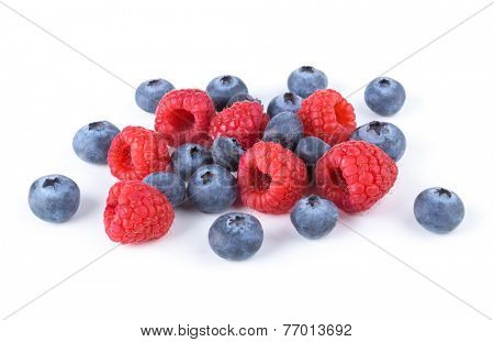 fresh raspberries and blueberries isolated on white background