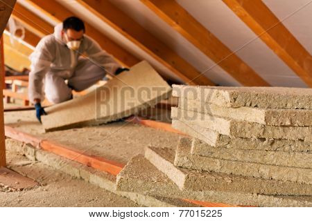 Man Laying Thermal Insulation Layer