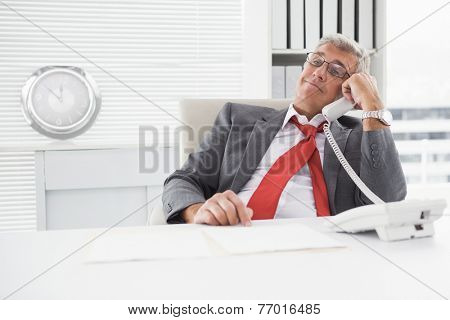 Disheveled businessman on the phone in his office