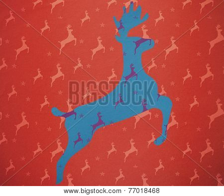 Reindeer running against blue and purple reindeer pattern