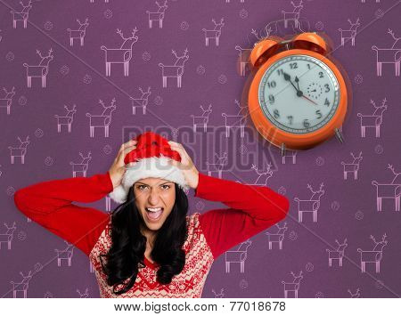 Irritated woman looking at camera against purple reindeer pattern