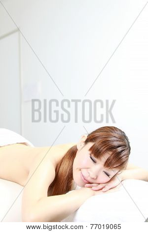 woman relaxing on massage bed