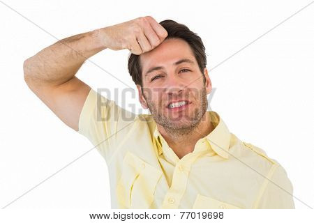 Handsome man with his hand on his forehead on white background