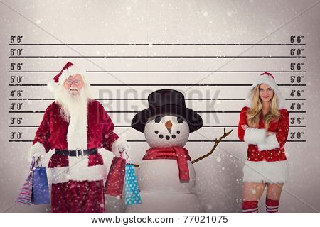 Santa carries some Christmas bags against mug shot background