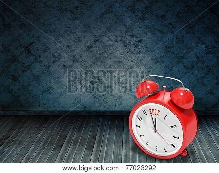 2015 in red alarm clock against dark grimy room