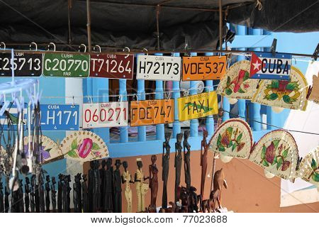 Cuban Plaques And Souvenir. In  Market On The Trinidad Street, In Cuba, Many Souvenir Such As Fans,