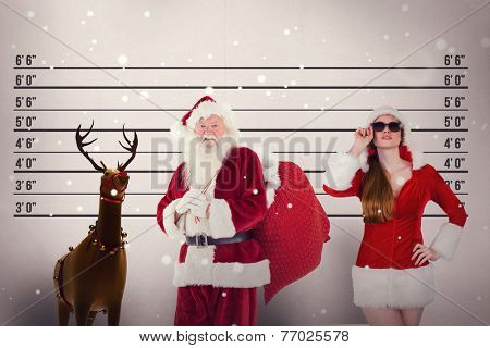 Santa carries his red bag against mug shot background