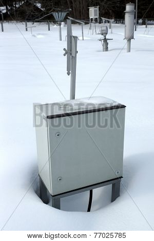 Technical metal box on snow.