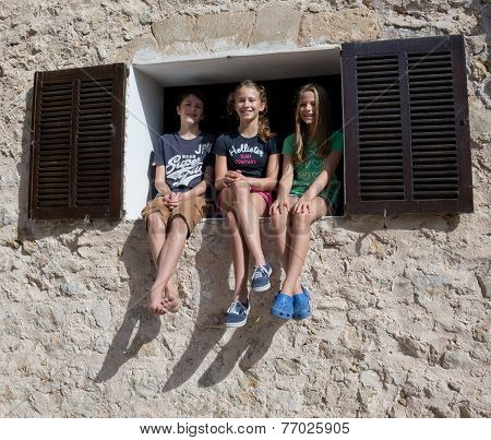 Three young giggly girls