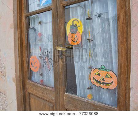 Children's drawings in a nursery window